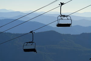 Chairlifts with Mountains in the background