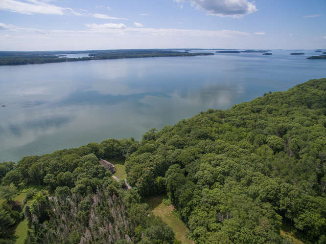 Maquoit Bay. Property has 199 feet private waterfront access.