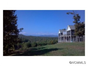 A western NC mountain home with a cool lake and blue mountains.