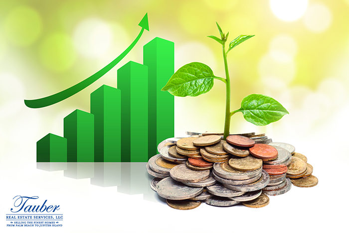 Green trees stacked on coins with rising chart resembles growing economy.