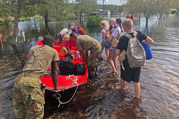 Defense.gov - News United States Department of Defense Coast Guardsmen and members of the North Carolina National Guard assist residents affected by flooding following