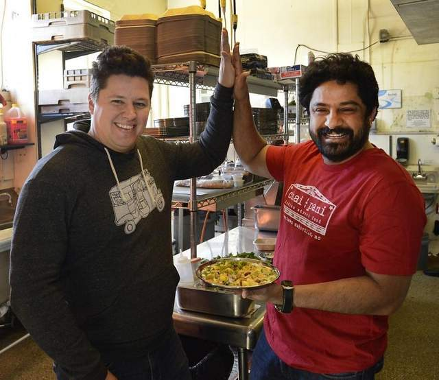 Michael Files and Meherwan Irani in the kitchen of their downtown restaurant Chai Pani. / Bill Sanders / wsanders@citizen-times.com