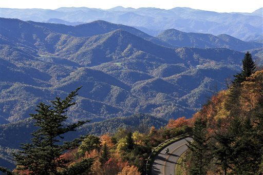This Sept. 2007 file photo released by the Explore Asheville shows a motorcyclist on a scenic fall drive along the Blue Ridge Parkway near Asheville, N.C. This gem of a city tucked in the Blue Ridge foothills of western North Carolina attracts artists, musicians, foodies, outdoor enthusiasts and a fair share of modern-day hippies, all lured by the beautiful setting and open-minded vibe. EXPLORE ASHEVILLE, VALERIE L. JENKINS -- AP Photo