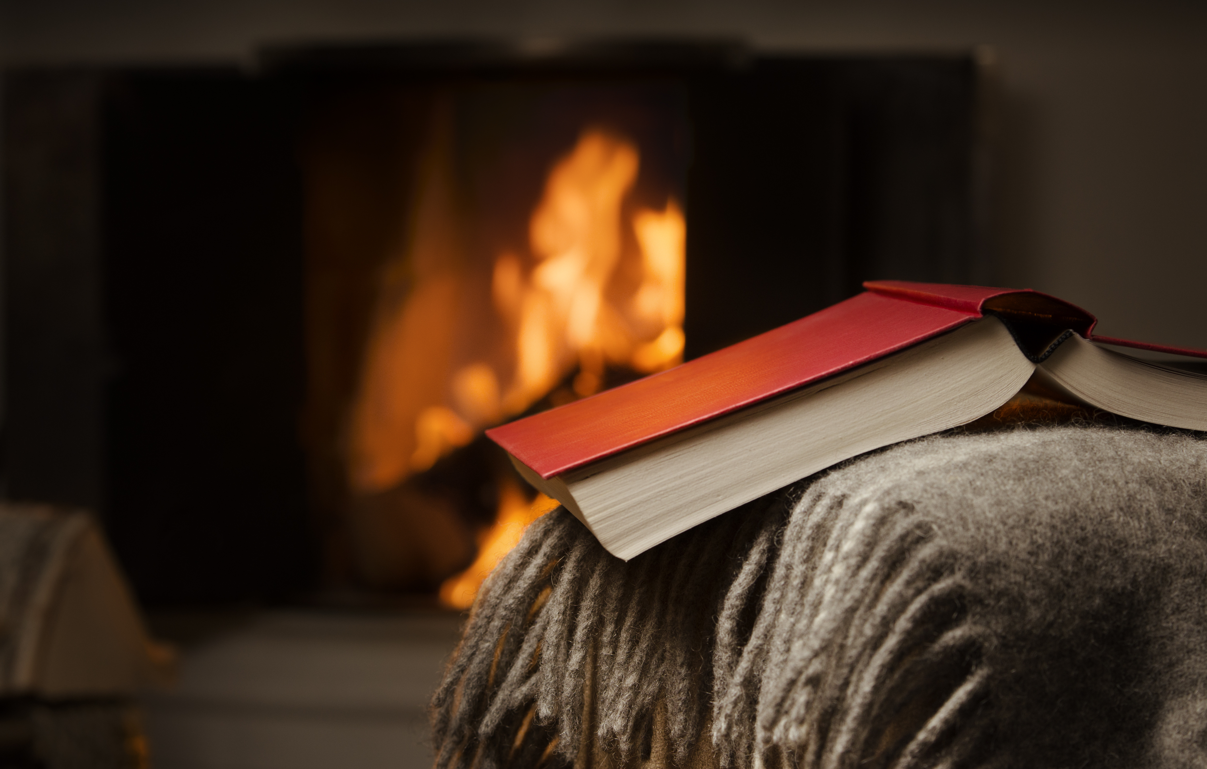Book in front of fireplace in Maine