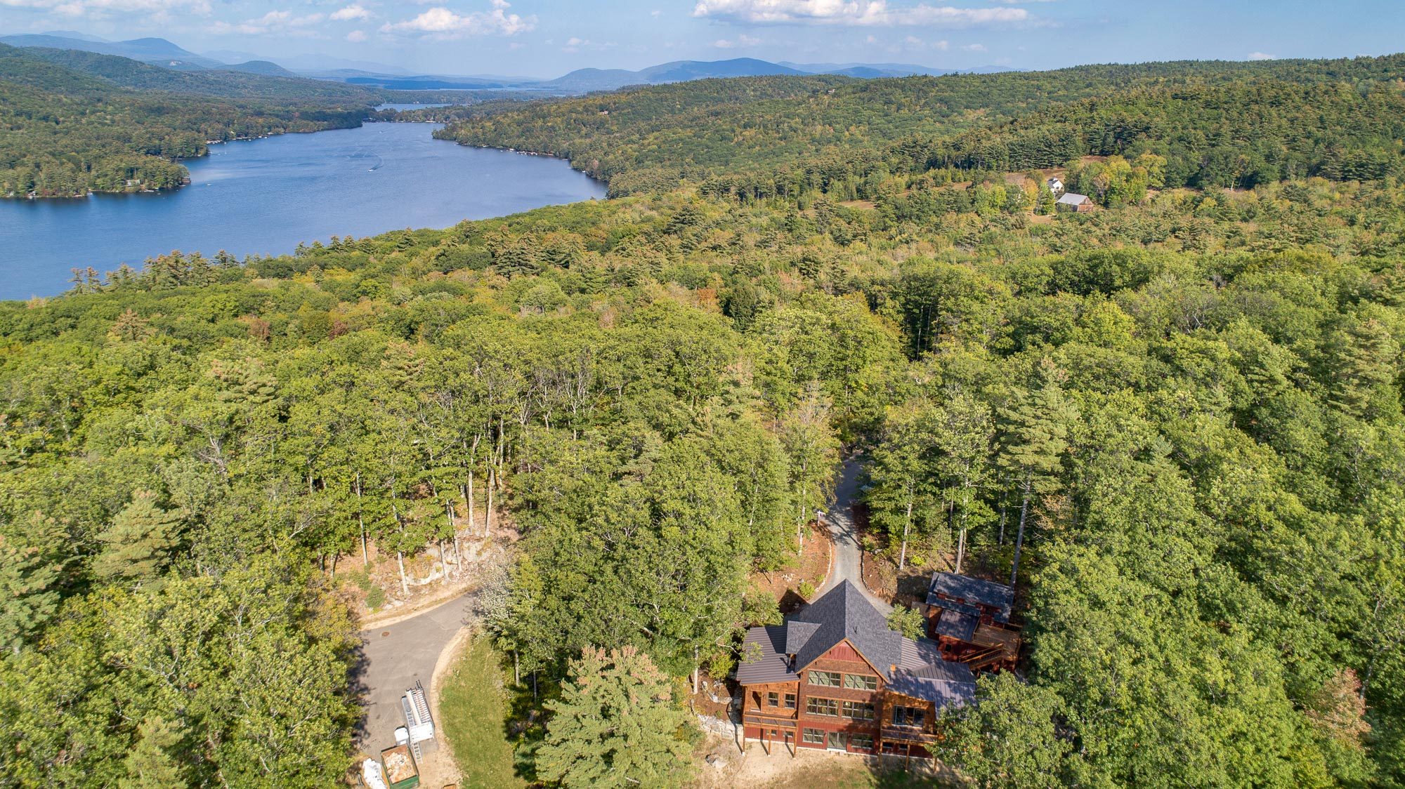 Squam Lake is at your footsteps with the purchase of this new construction home.