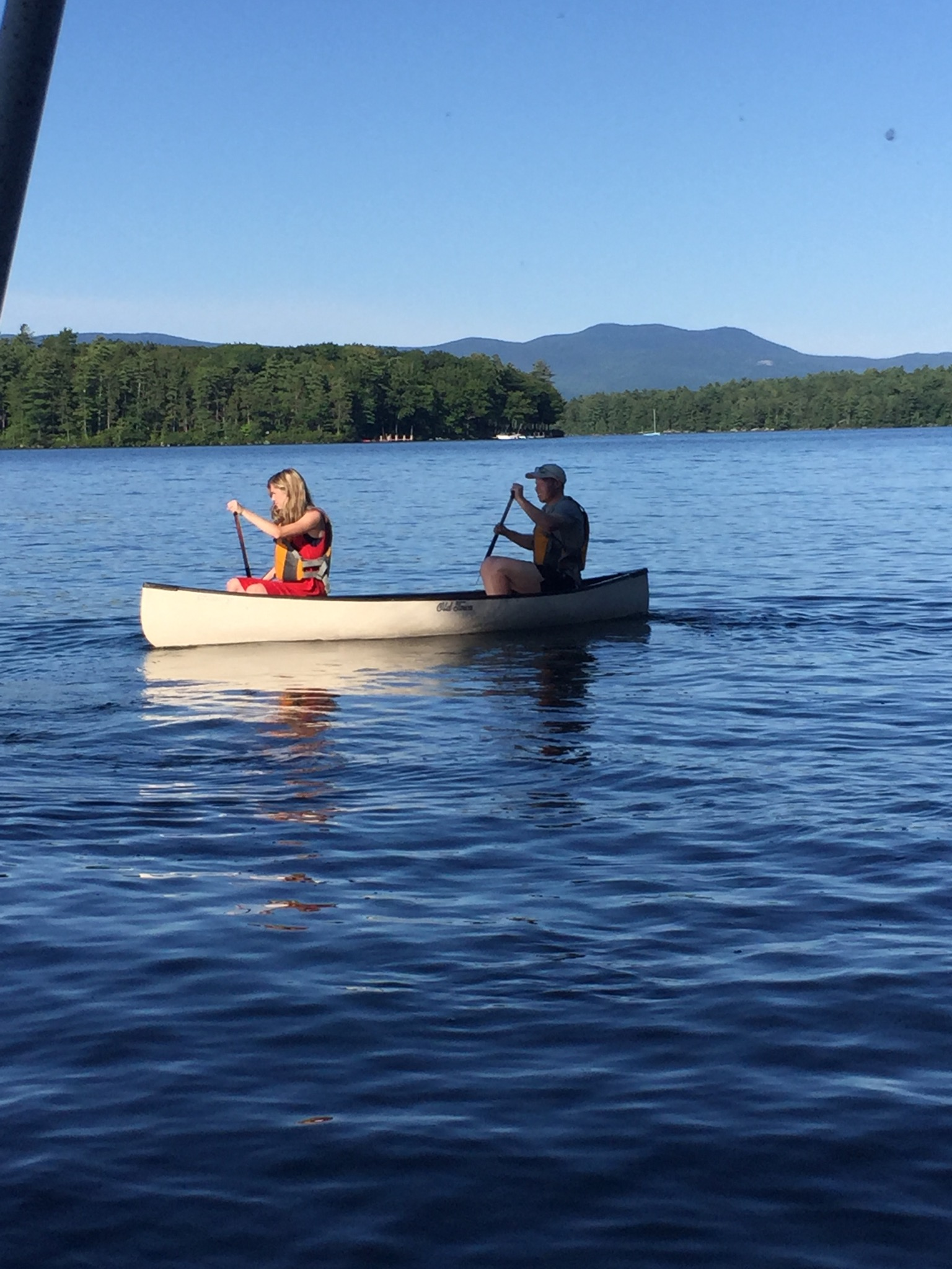 canoeing by 144 Veasey Shore Road's Winnipesaukee Shoreline in a Winni Lifestyle Video.