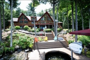 15 Olive Street in summer offers spectacular views, extensive decking, many lakeside sitting areas, 2 mahogany, covered porches, perched permit in place for a large perched beach and a custom home with ample room for entertaining. In winter, 15 Olive Street is conveniently located just 15 minutes from Gunstock SKi Resort or the indoor tennis courts at Gilford Hills. (My clients tell me that some of the best tennis teachrs in the country can be found at Gilford Hills!)
