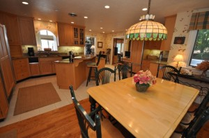 Deerhaven's kitchen in the main home is a great gathering area. but all 3 homes have their own kitchens. NH Lake homes such as 112 and 115 Deerhaven are perfect for entertaining fridns and family for extended vacations or long weekends.