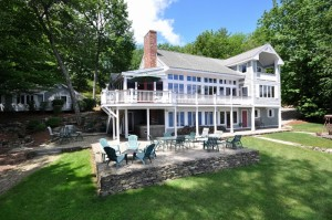 Deerhaven has lakeside patios great for entertaining. This estate property comfortably sleeps twenty people.