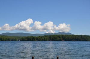 Direct view from the dock at 291 Long Point in Moultonborough looks towards far Echo and majestic Mountains.