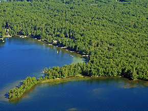 Winnipesaukee's Norway point is distinctive in all aspects. White sand shoreline, spectacular views, wide and long....hinting at the breadth of Winnipesaukee herself, while offering protection within the long arms of the cove.