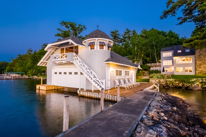 The twilight brings out the best in this Winnipesaukee Eagelmere property.