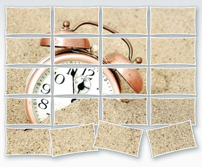 picture of clock in sand