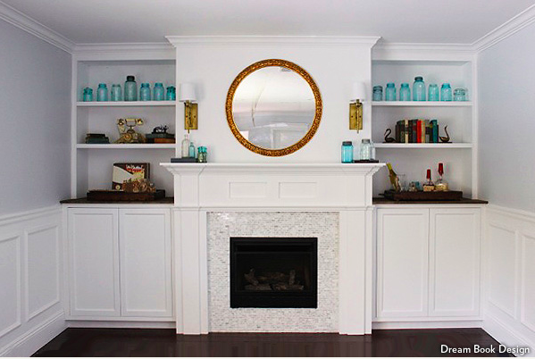 Gas fireplace surrounded by built in cabinets and storage