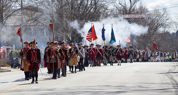Reenacters march in Beford in honor of the 53rd annual pole capping ceremony