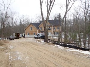 A custom home under construction on the Northland Road cul-de-sac at Spruce Pond Estates