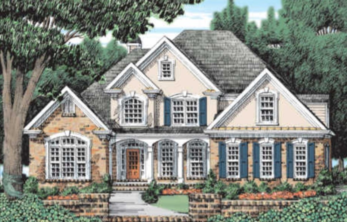Fairy Tale Exterior Photo of a Cream Colored Two-Story Brick Home with Blue Shutters
