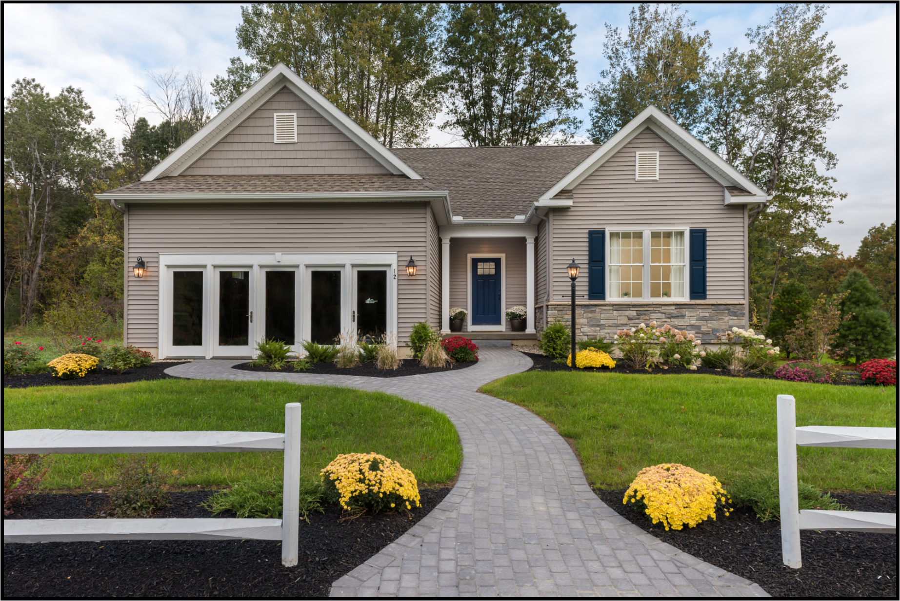 Exterior Photo of a Ranch Style Home - Gray with Stone