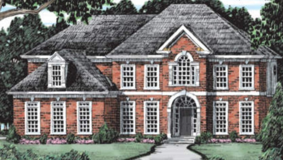 Fairy Tale Exterior Photo of a Two-Story Brick Home with White Trim