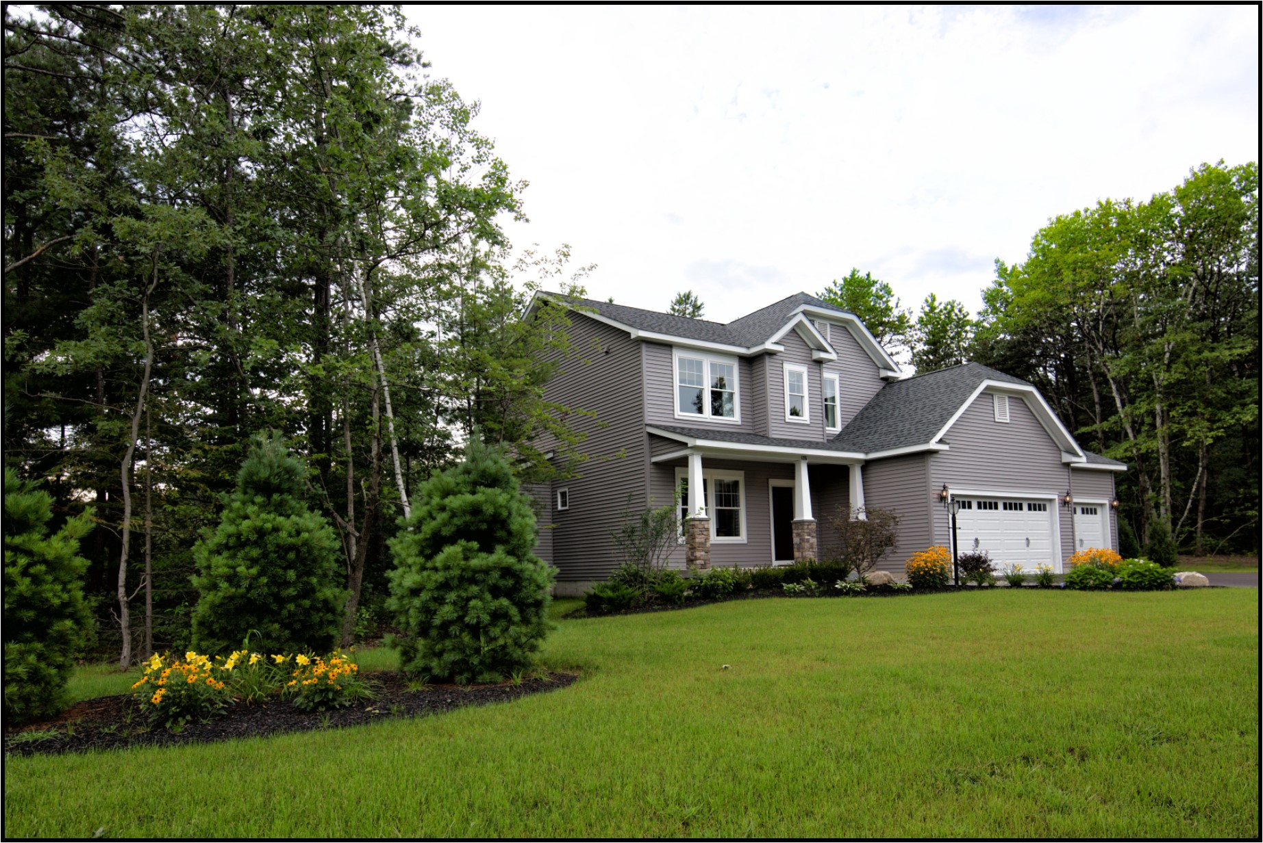 Exterior Photo of Two Story Home with Woods and Landscaping - Gray