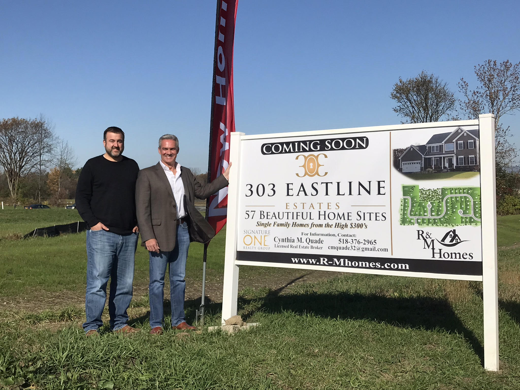 R&M Builders Standing with Sign of 303 Eastline Estates - Ballston Spa Community