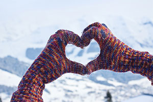 winter hands in the shape of a heart