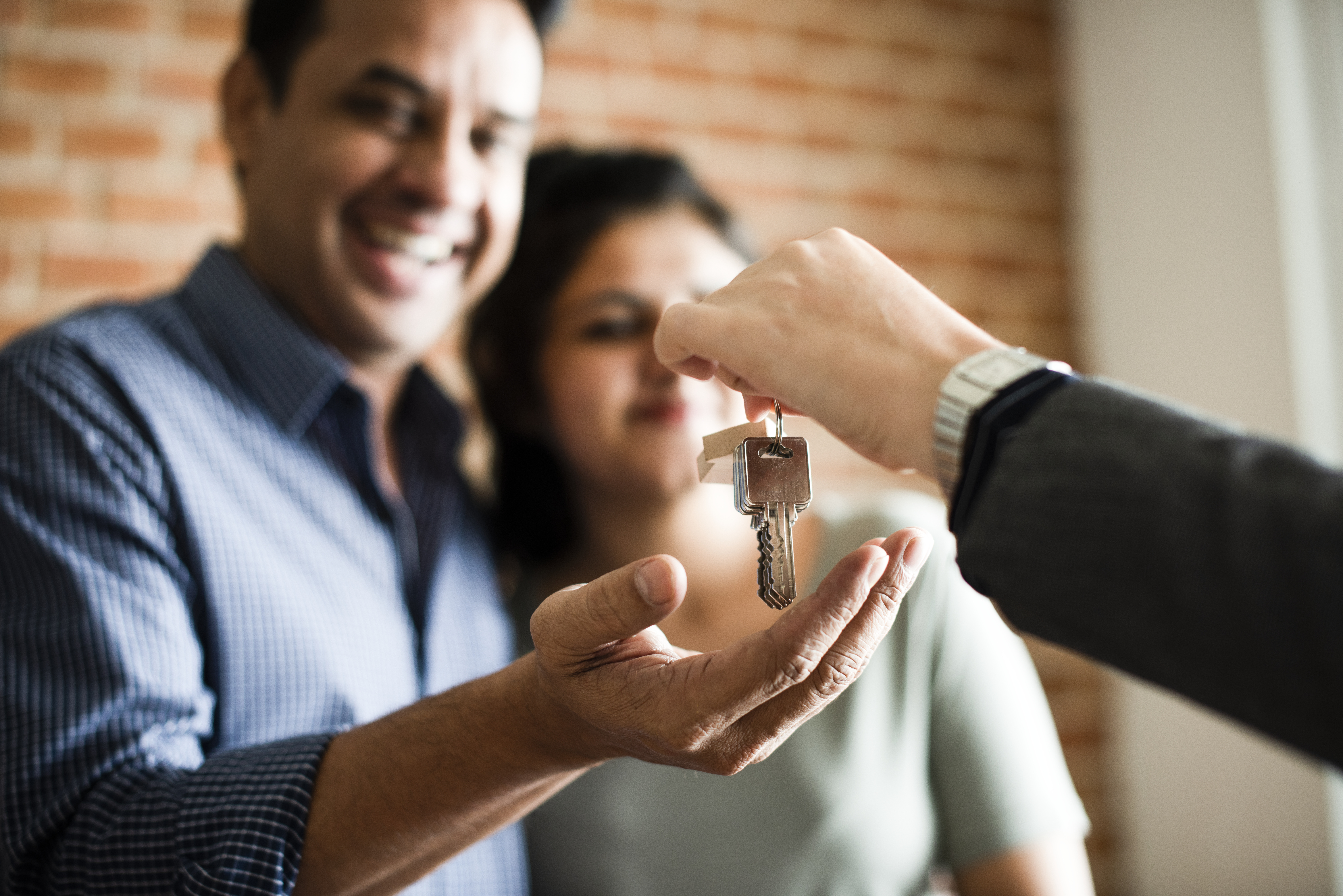 A homebuyer receiving the keys to their new home