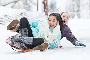 Two Teen Girls Sledding
