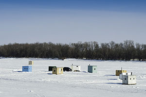 Ice Fishing Huts on the Lake