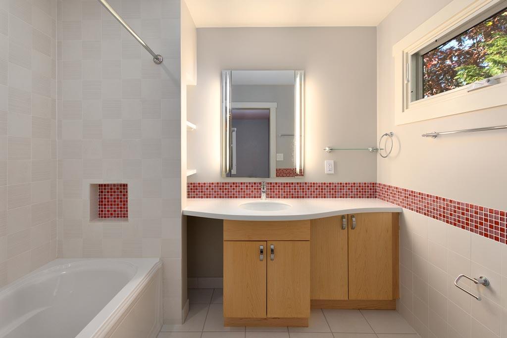 En Suite Bathroom with Soaking Tub. Custom Tile Vanity.