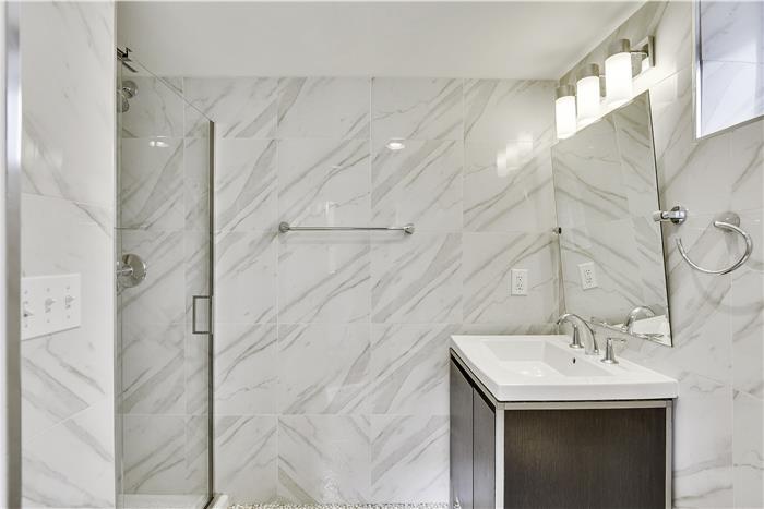 Glass shower & tiled master bath