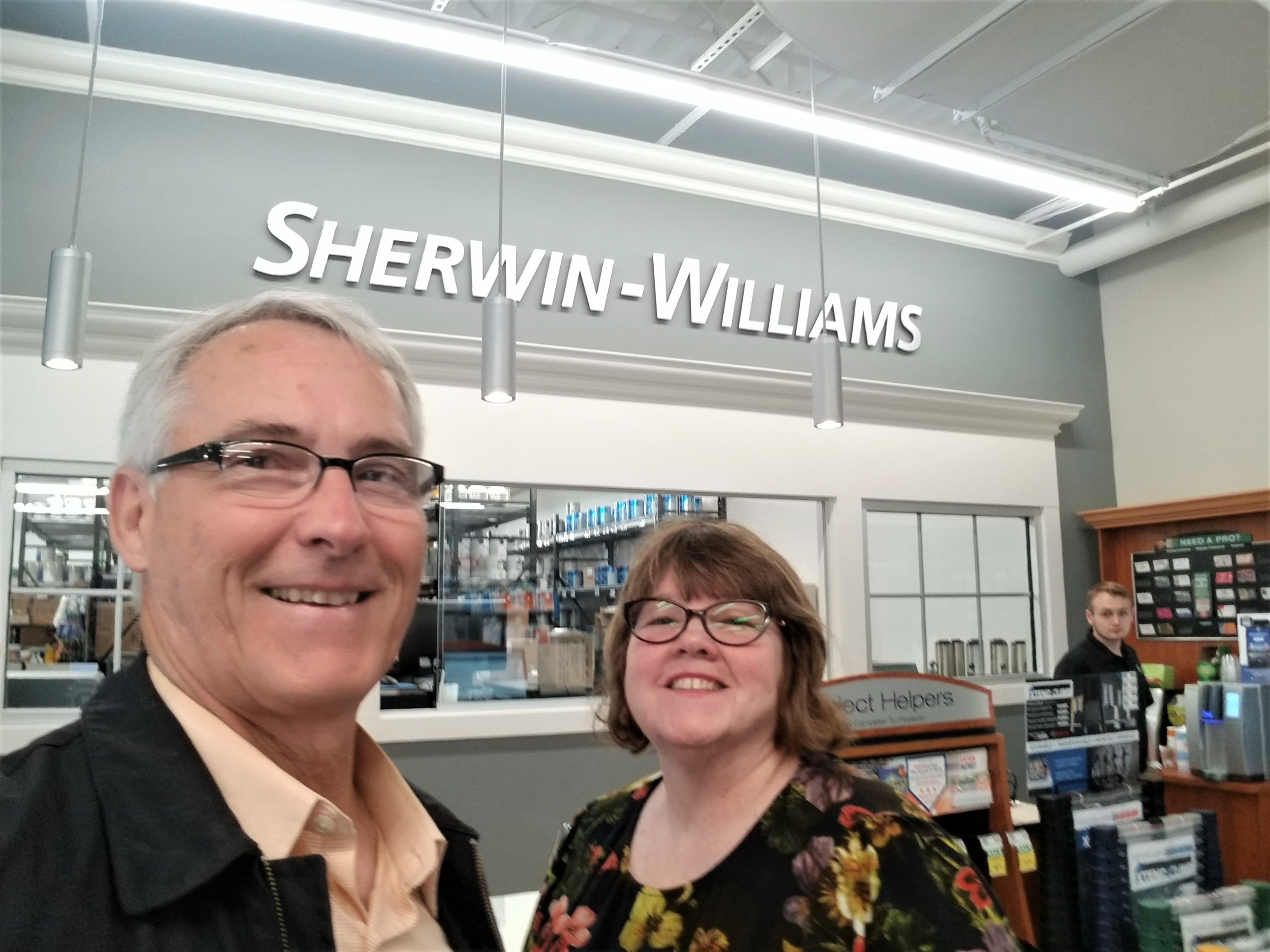 Ann Devane and Peter Prasinos at Grand opening Sherwin Williams