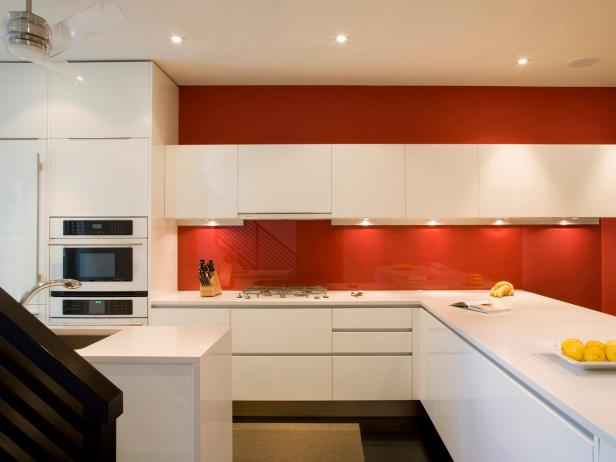 Sleek Modern Kitchen With Red Accent Wall