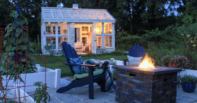 Patio with fire pit and shed