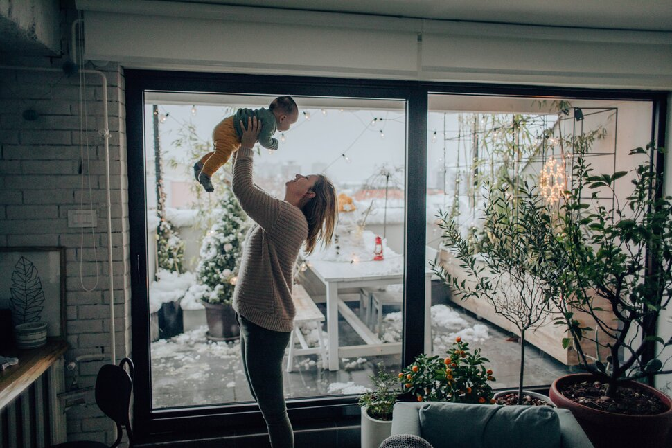 Couple in front of new home