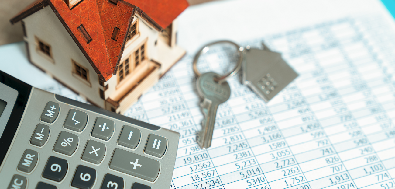 calculator, home and keys mortgage rates