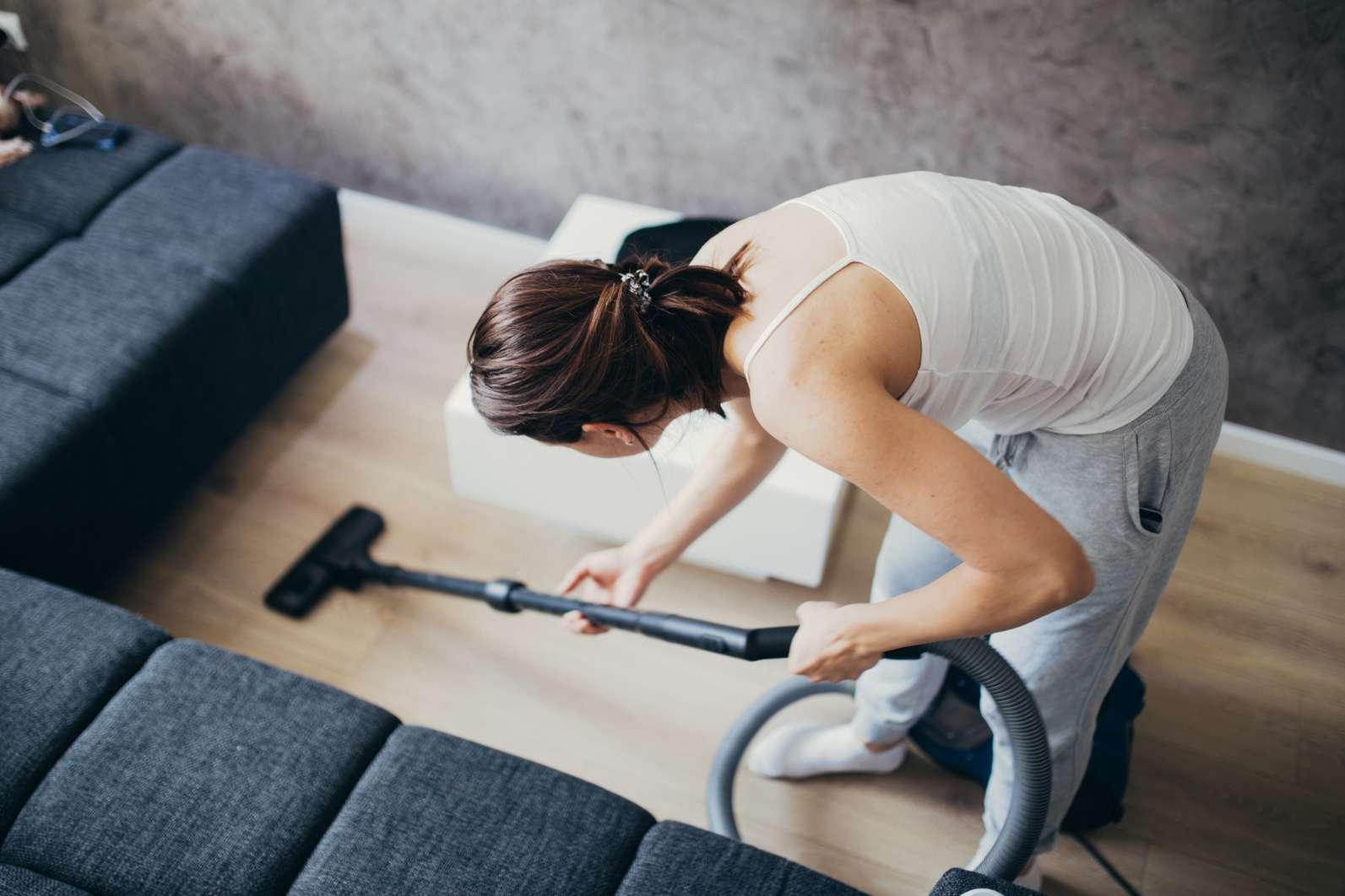 lady vacuuming floor