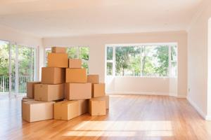 stacked boxes in empty room
