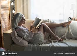 lady reading book on couch