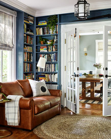 sofa french doors and bookshelves