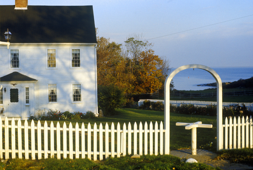 East coast home surrounded by white picket fence. Biddeford Maine