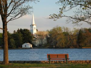 View of a bench on the river in Braintree MA
