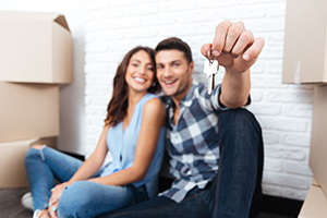 Home Buyers with Keys to New Home