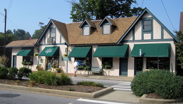 Biltmore Village shops are a big draw for people relocating and buying homes for sale in South Asheville. The best Asheville NC Real Estate agency to find a luxury home for sale is CENTURY 21 Mountain Lifestyles. Photo: Wikimedia Commons