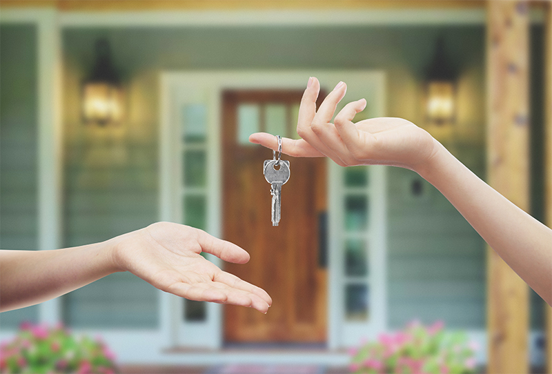 A home buyer receiving the keys to their new house