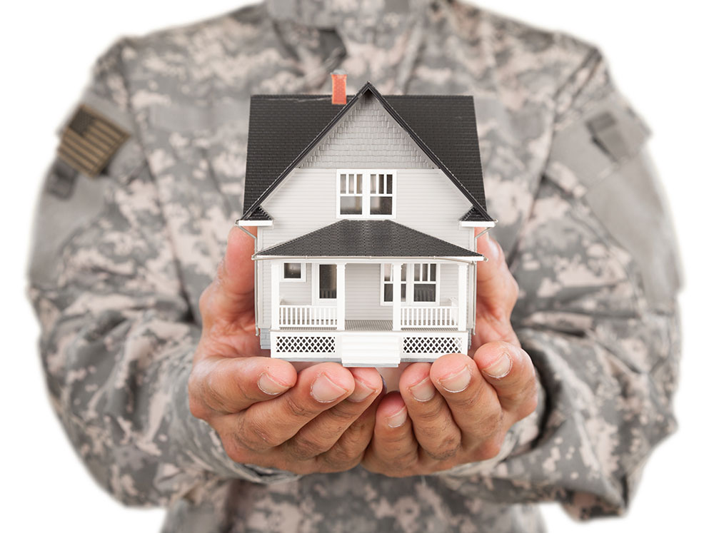 Veteran Holding Home in Hands