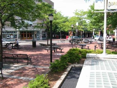 outdoor seating and tables within an urban park in Somerville, MA
