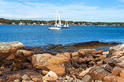 A beachside image of two sailboats in Canaan NH