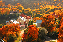 An aerial view of the town of Grantham, NH during peak foliage season.