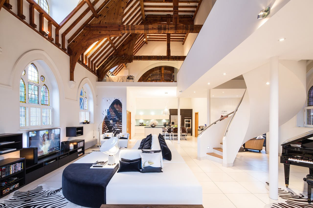 In London, a late-1800s brick church was converted into a single-family home. The church's roof structure was left exposed, while and a mezzanine was inserted into the building to take advantage of the high ceilings.